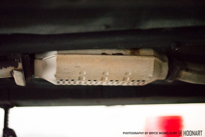 Old rust cat in place on Miata