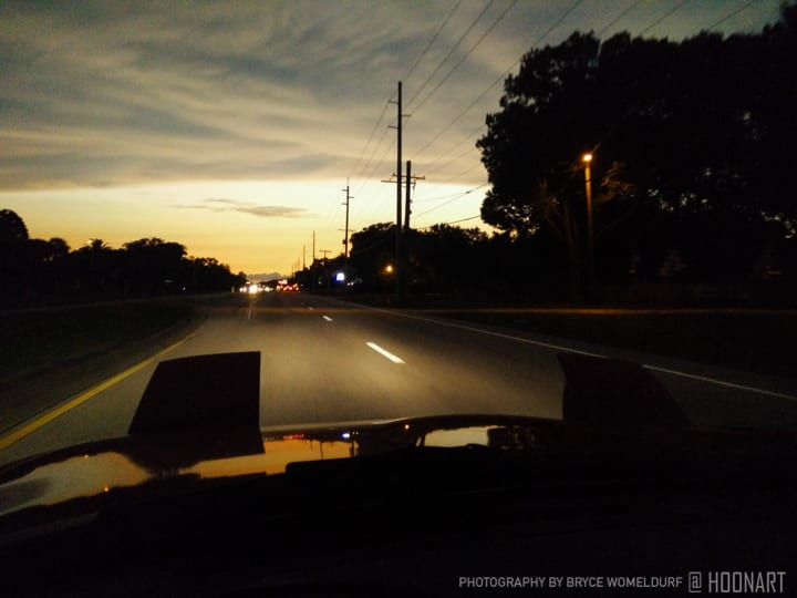 Miata driving into the sunset