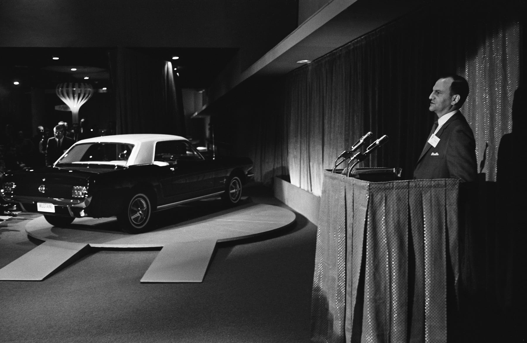 Lee Iacocca introduces the new 1965 Ford Mustang to the media in the Ford Pavilion at the 1964 World's Fair in New York.