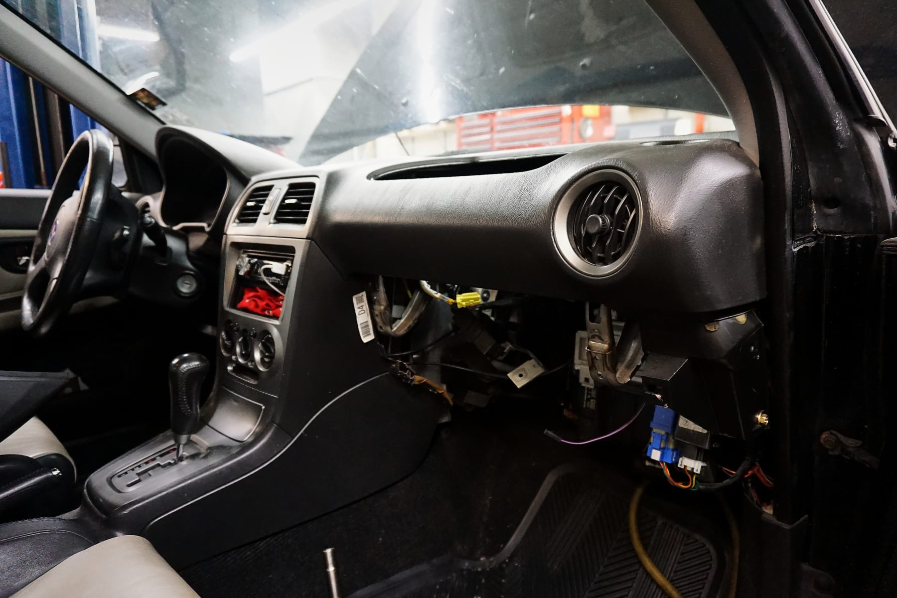 The dashboard in surgery to remove the recalled Takata airbag