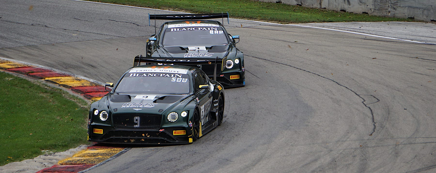 The dueling pair of Bentley Continental GT3s hammering into Canada Corner at Road America