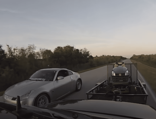 Watch this modded Nissan 350Z lose a race to a modded Mercedes-Benz E55… pulling a trailer